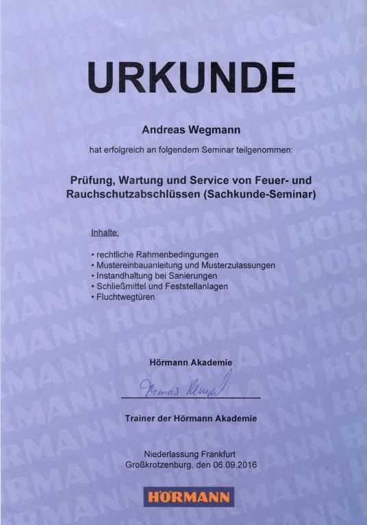 Urkunde Prüfung, Wartung und Service von feuer- und Rauchschutzabschlüssen (Sachkunde-Seminar) - Schmiede und Schlosserei Wegmann aus Heiligenhaus